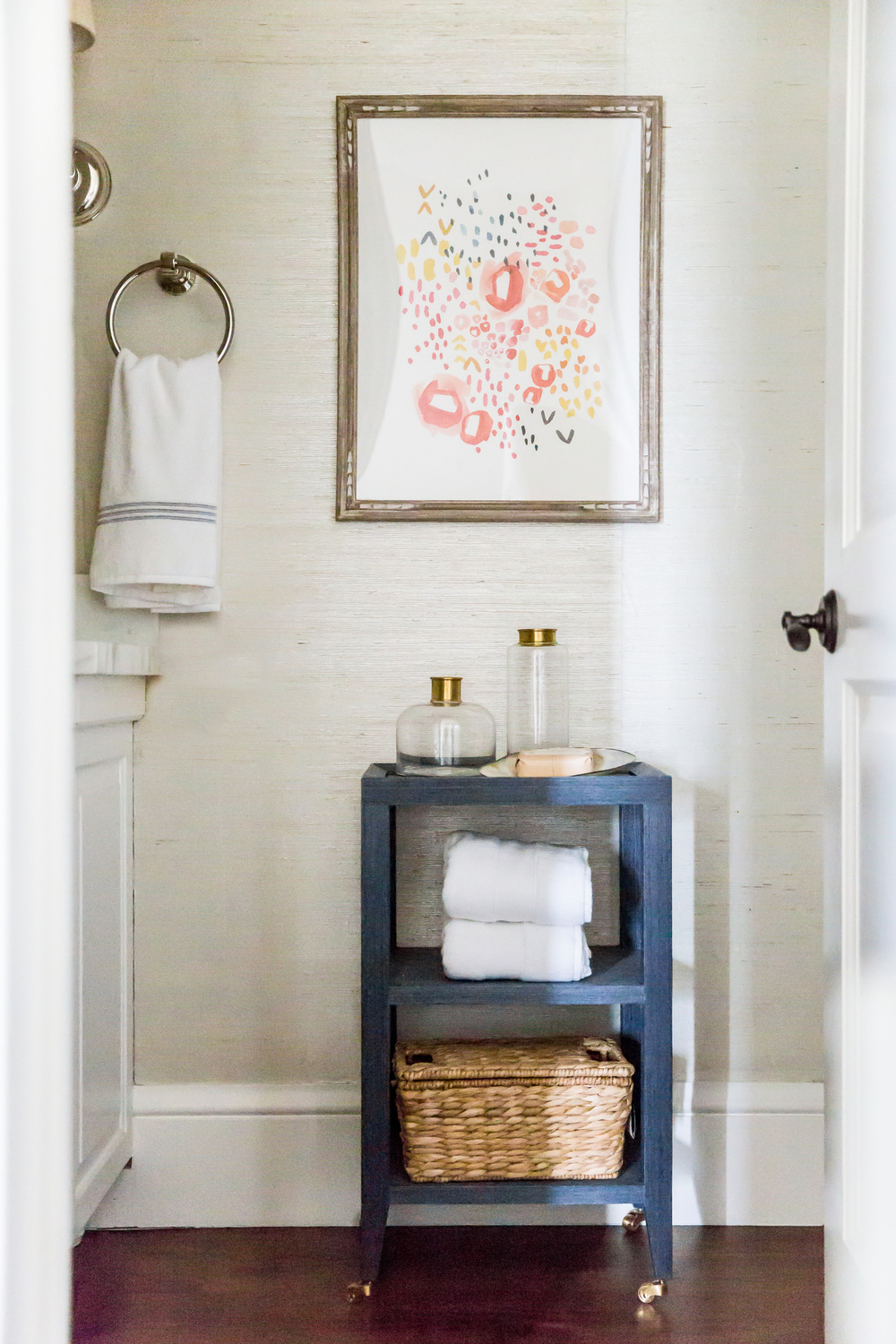 Small blue bathroom shelves beside toilet