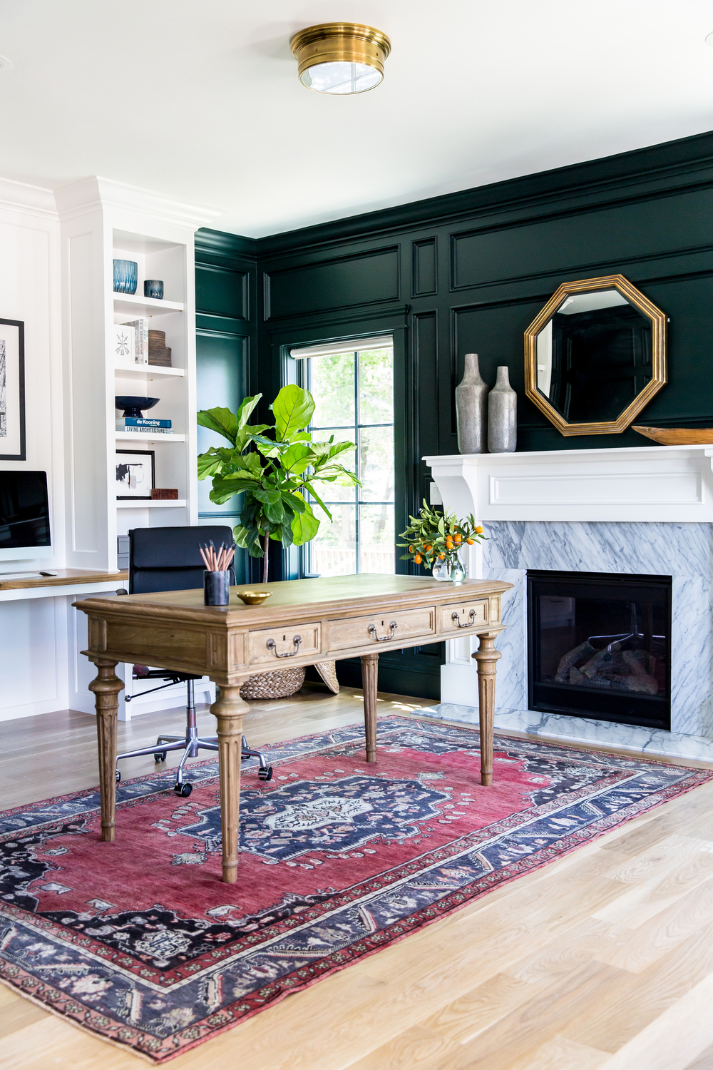 Green-black+paneled+walls+and+marble+fireplace+||+Studio+McGee.jpg