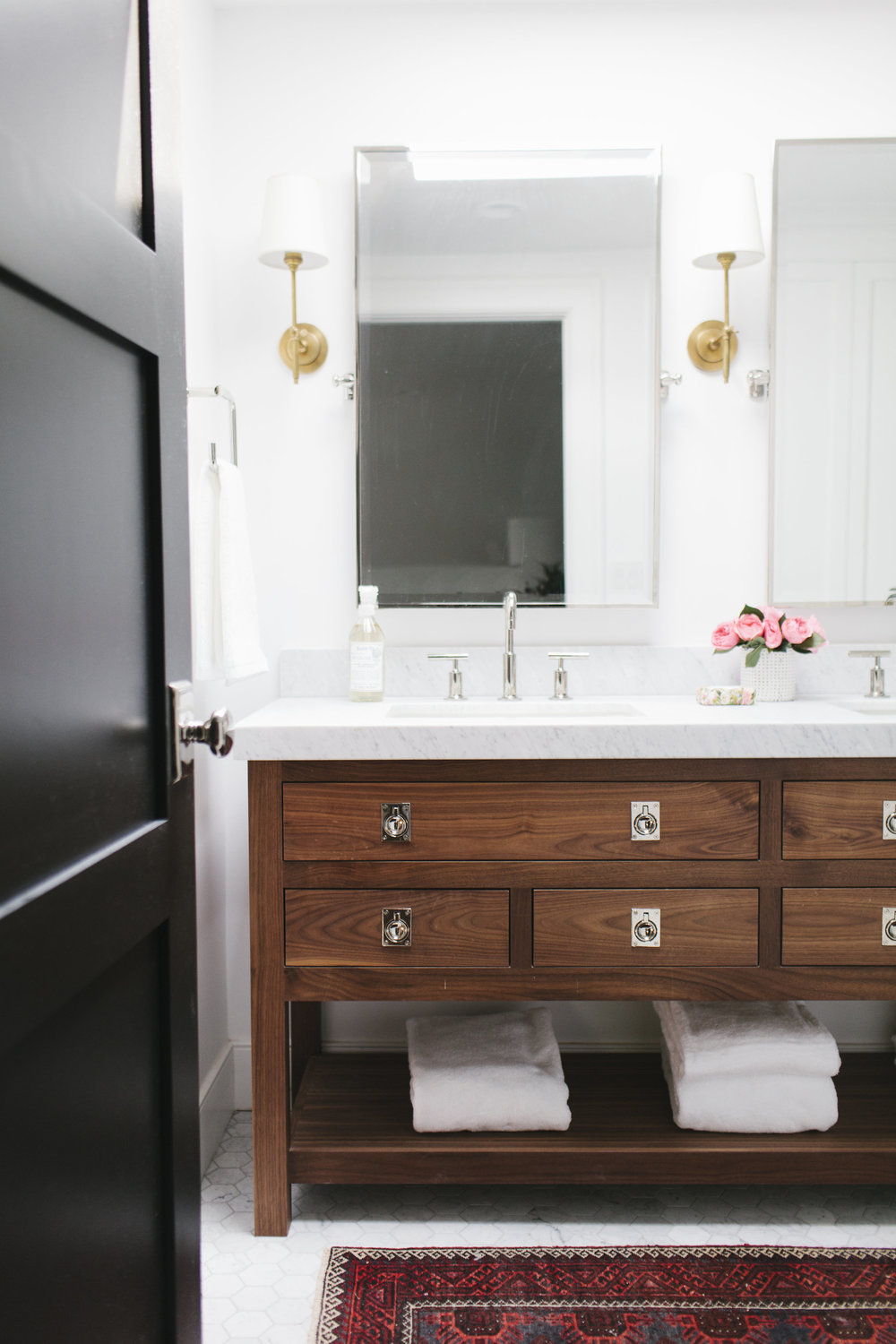 In our lynwood remodel the combination of wood and marble with polished nickel and brass fixtures creates a bathroom thats equal parts rich and warm