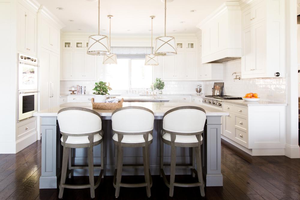 Creamy white cabinets and gray islands || Studio McGee