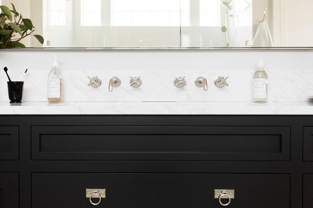 Wall mounted faucets and ring pulls in our Windsong Project || Studio McGee