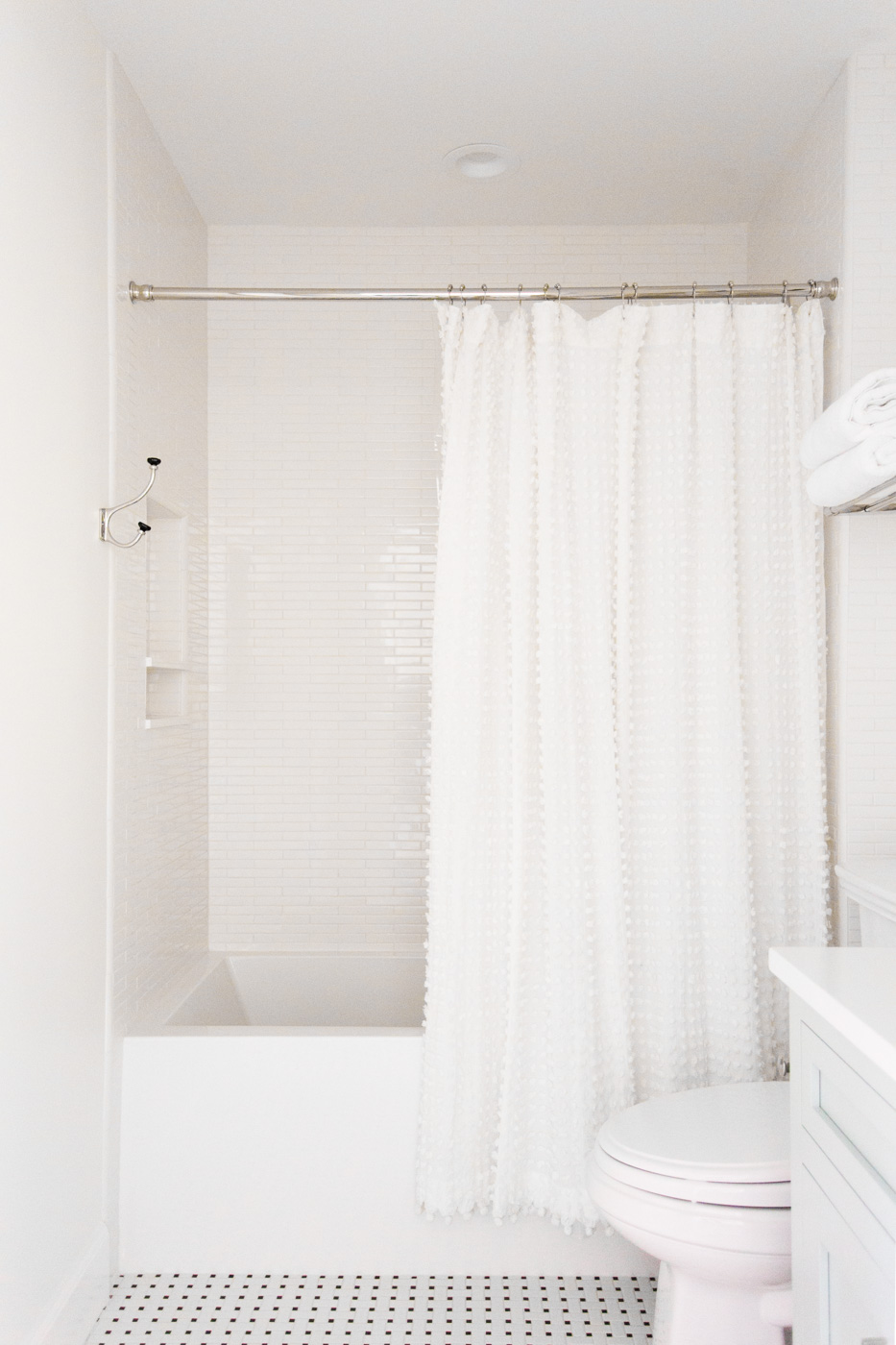 Black/white tile and pom pom shower curtain || Studio McGee