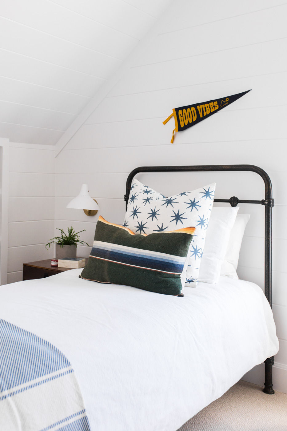 Cute boy's room with iron bed and good vibes pennant || Studio McGee