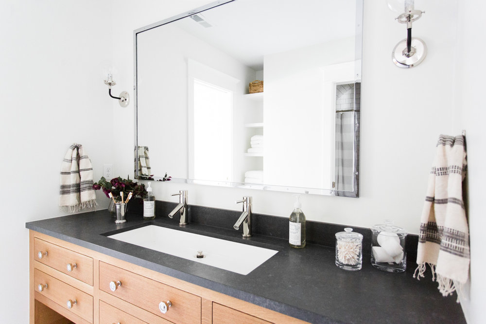 Natural Wood Vanity with dark gray countertop || Studio McGee