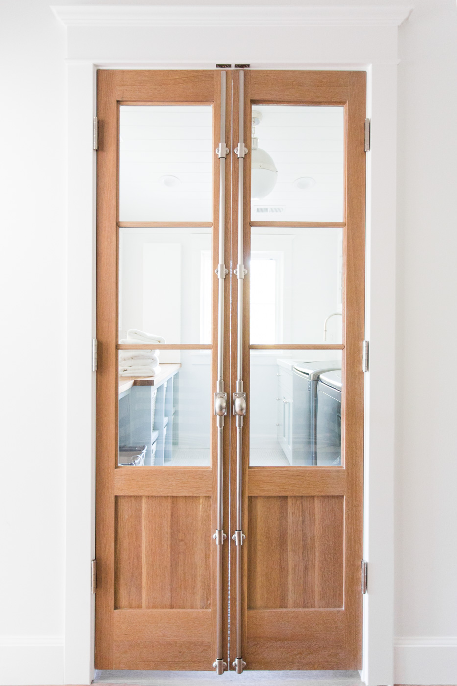 Natural wood doors with cremone bolt || Studio McGee