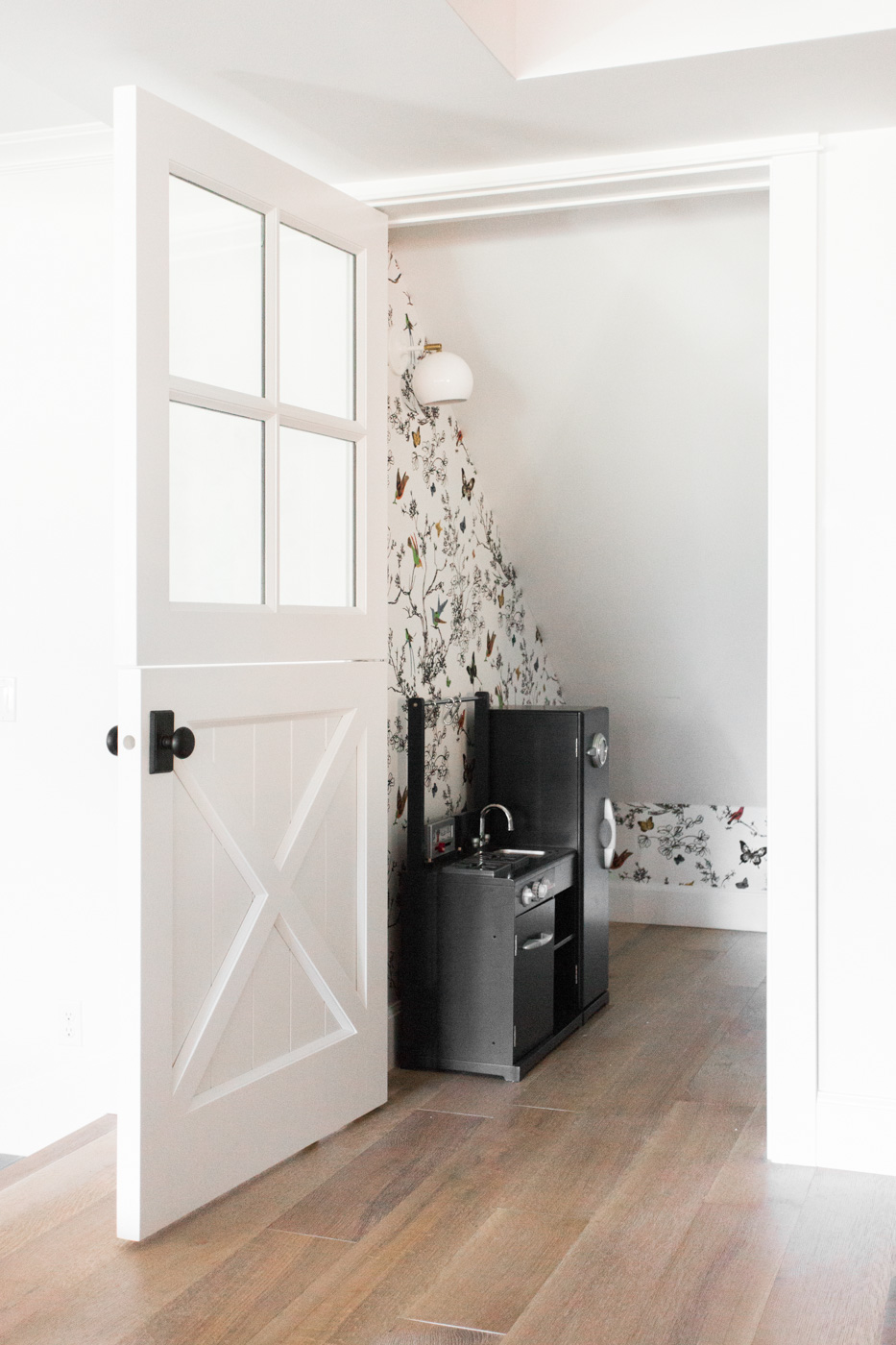 Closet playroom with dutch door and wallpaper || Studio McGee