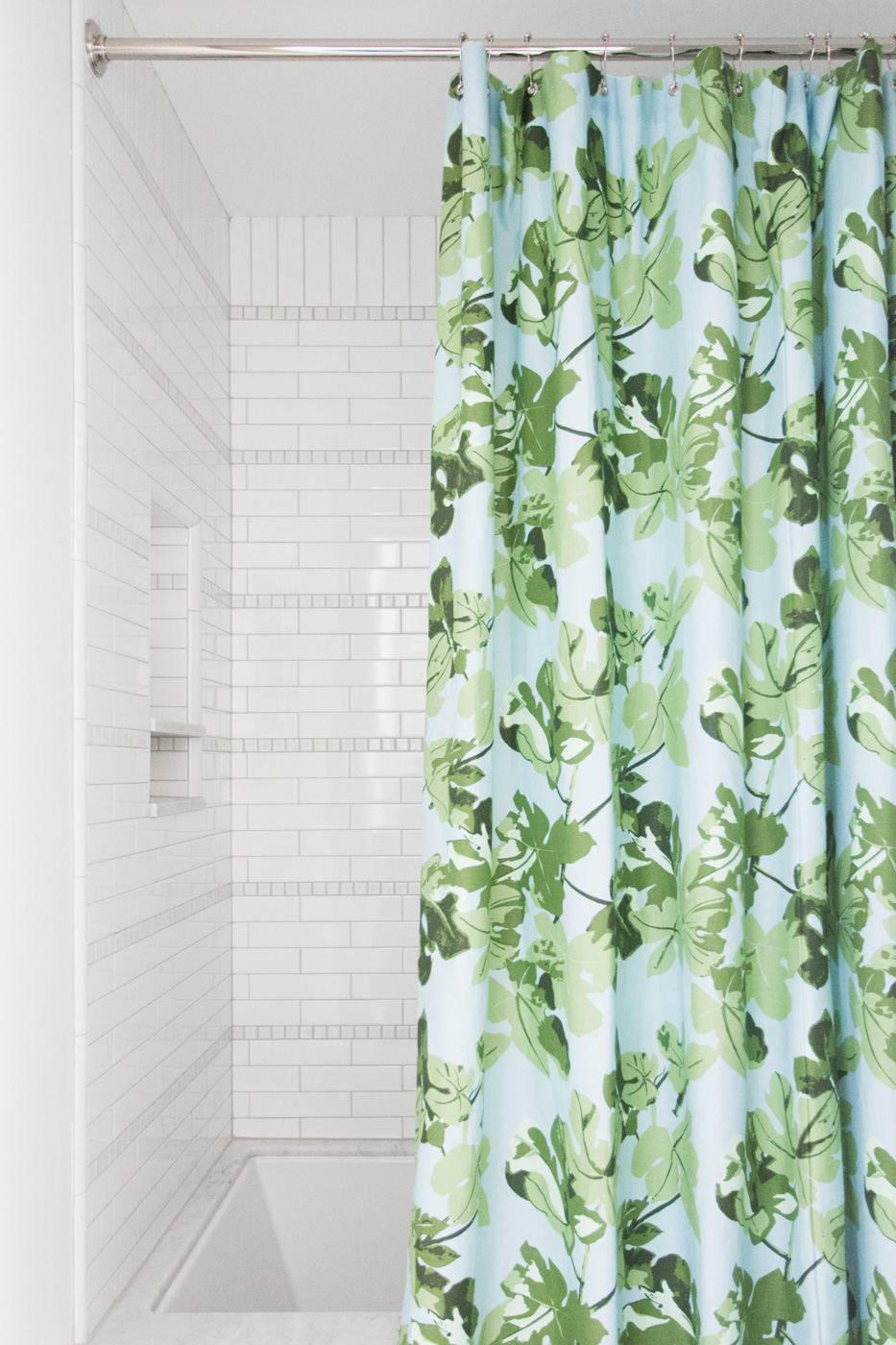 Patterned shower curtain and striped tile detail || Studio McGee