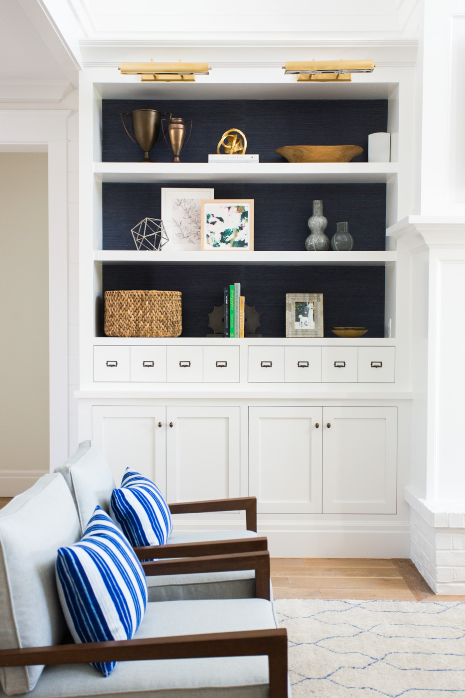 White chairs with built in shelves in background