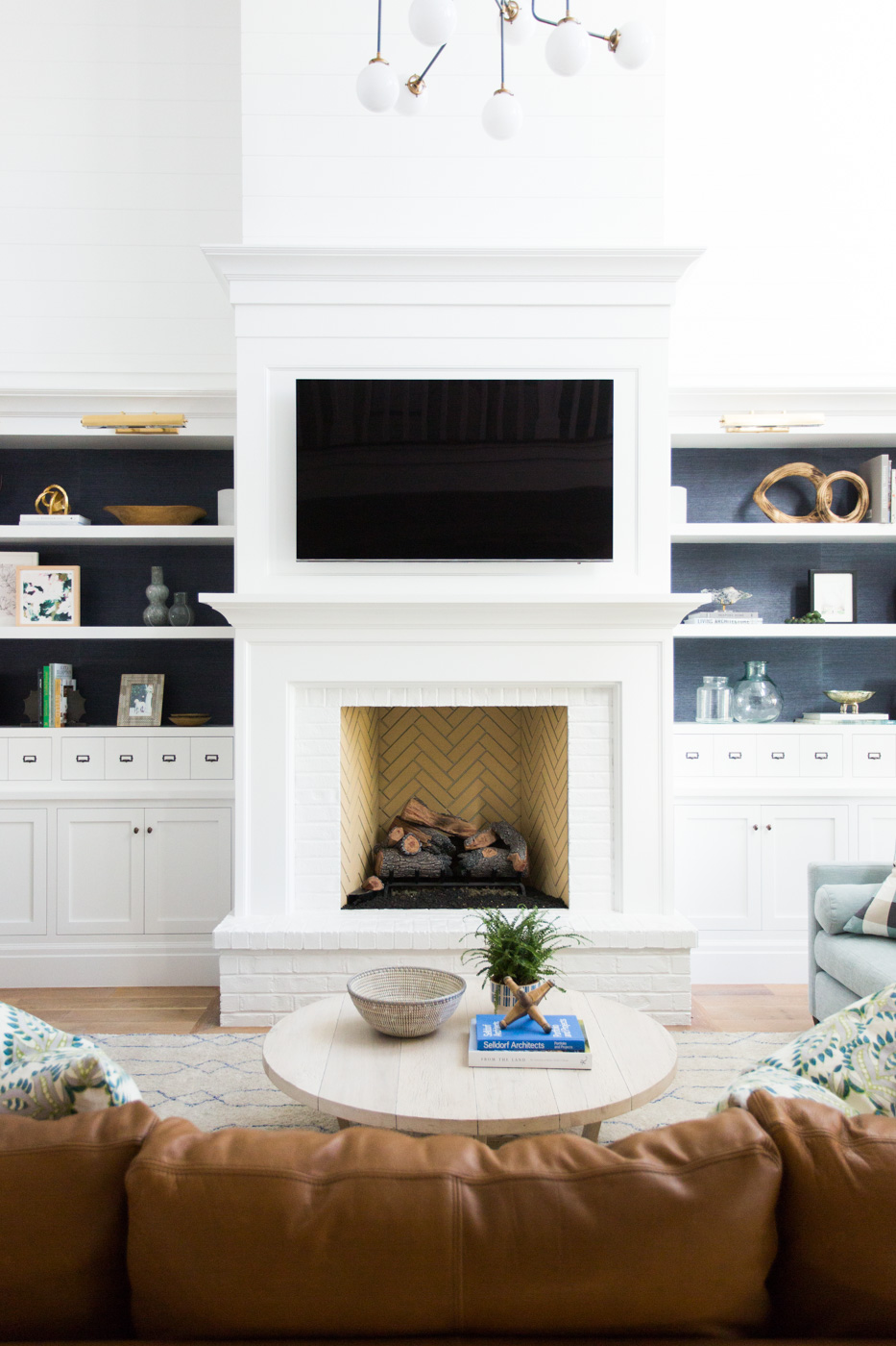 White minimalist fireplace from couch