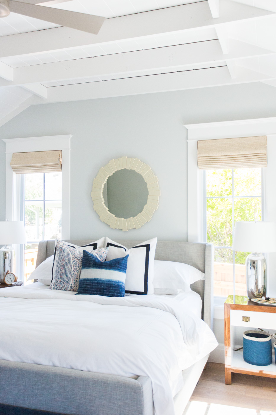 White bed beneath white ceiling in bedroom