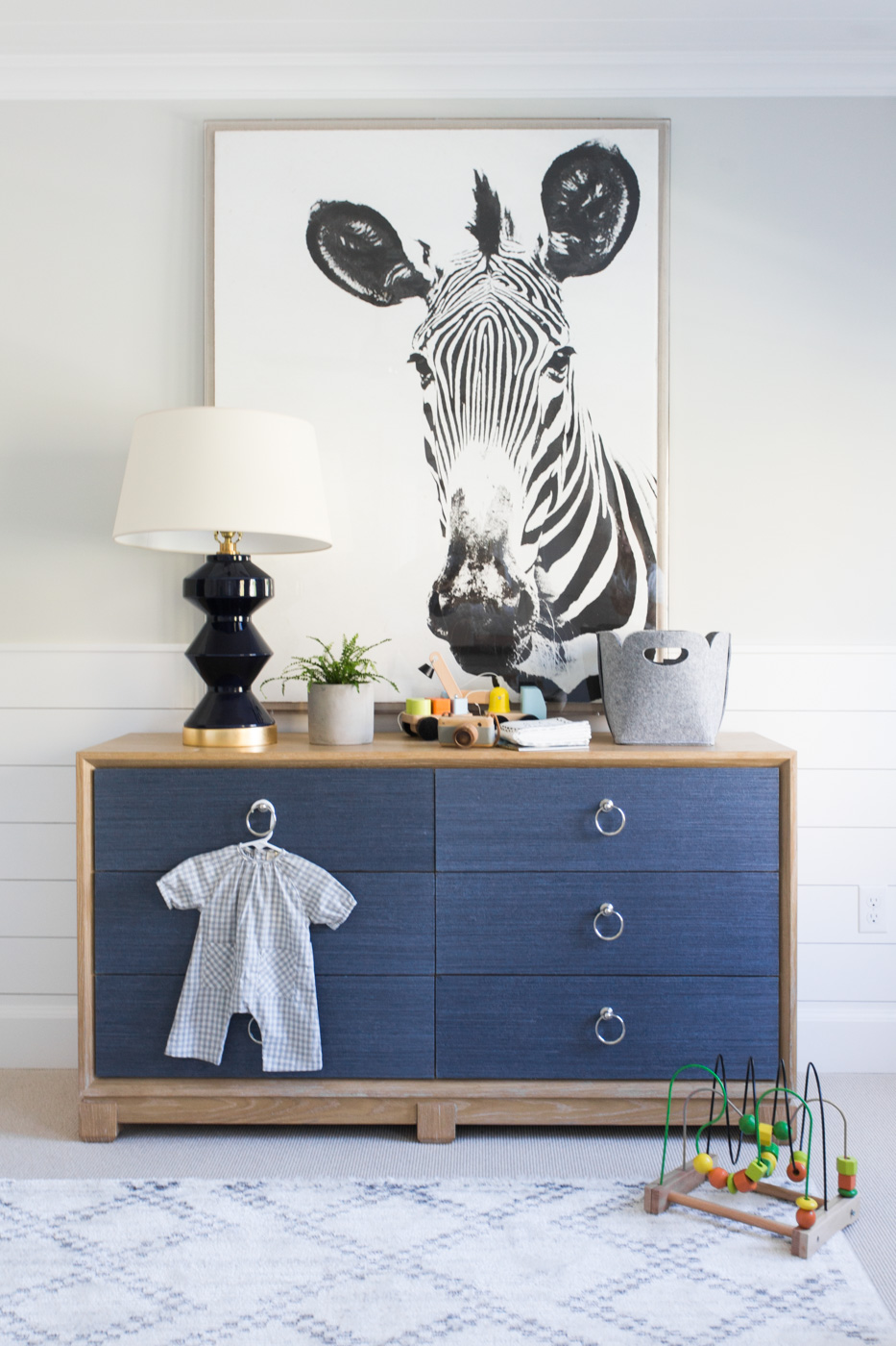 Zebra artwork above blue dresser