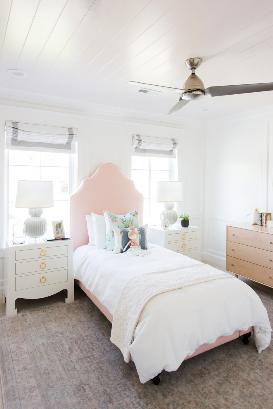 White twin bed on large area rug