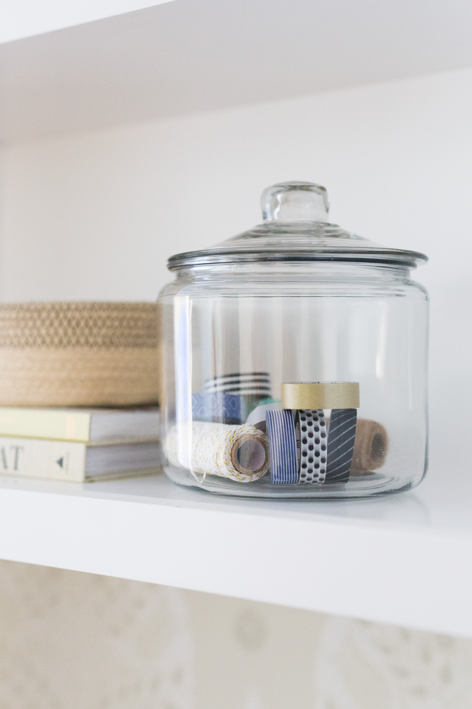 Glass jar decoration on shelves in office