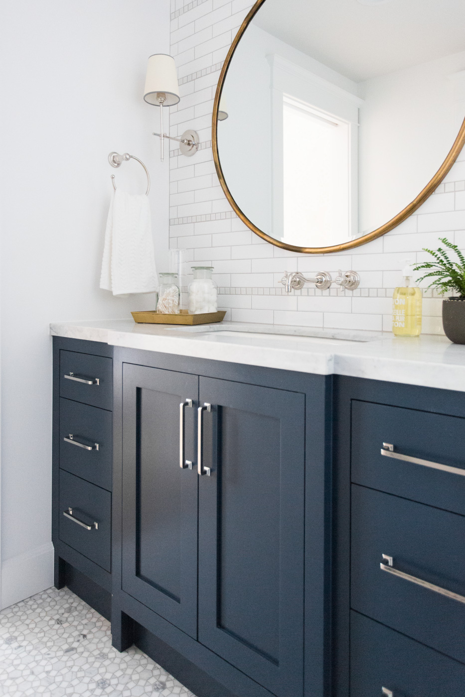 Blue cabinet details on bathroom vanity