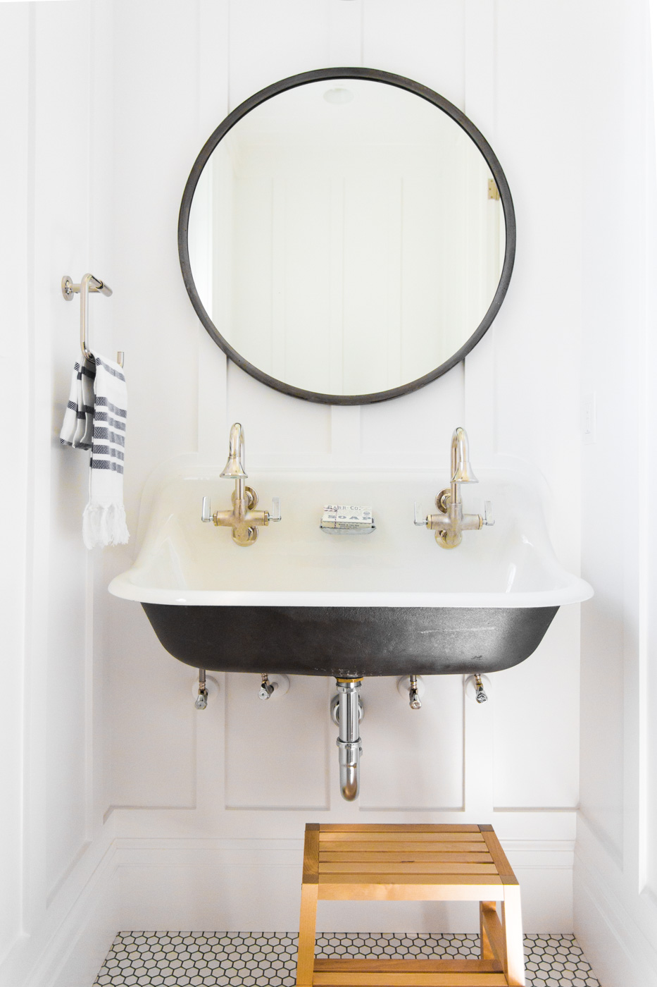 Wooden stepping stool beneath bathroom vanity