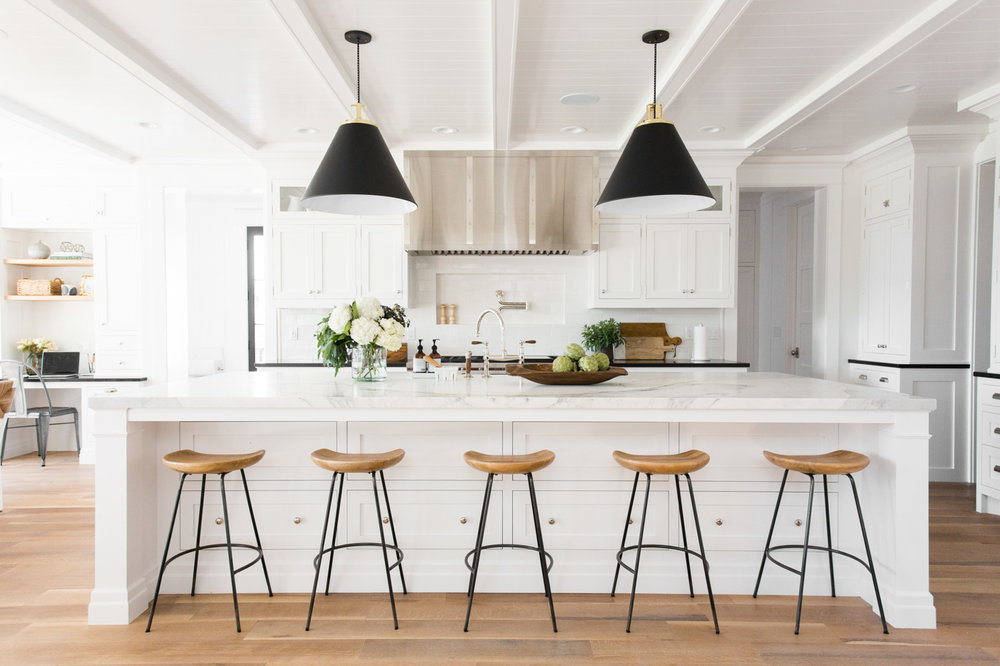 five metal stools in front of kitchen island