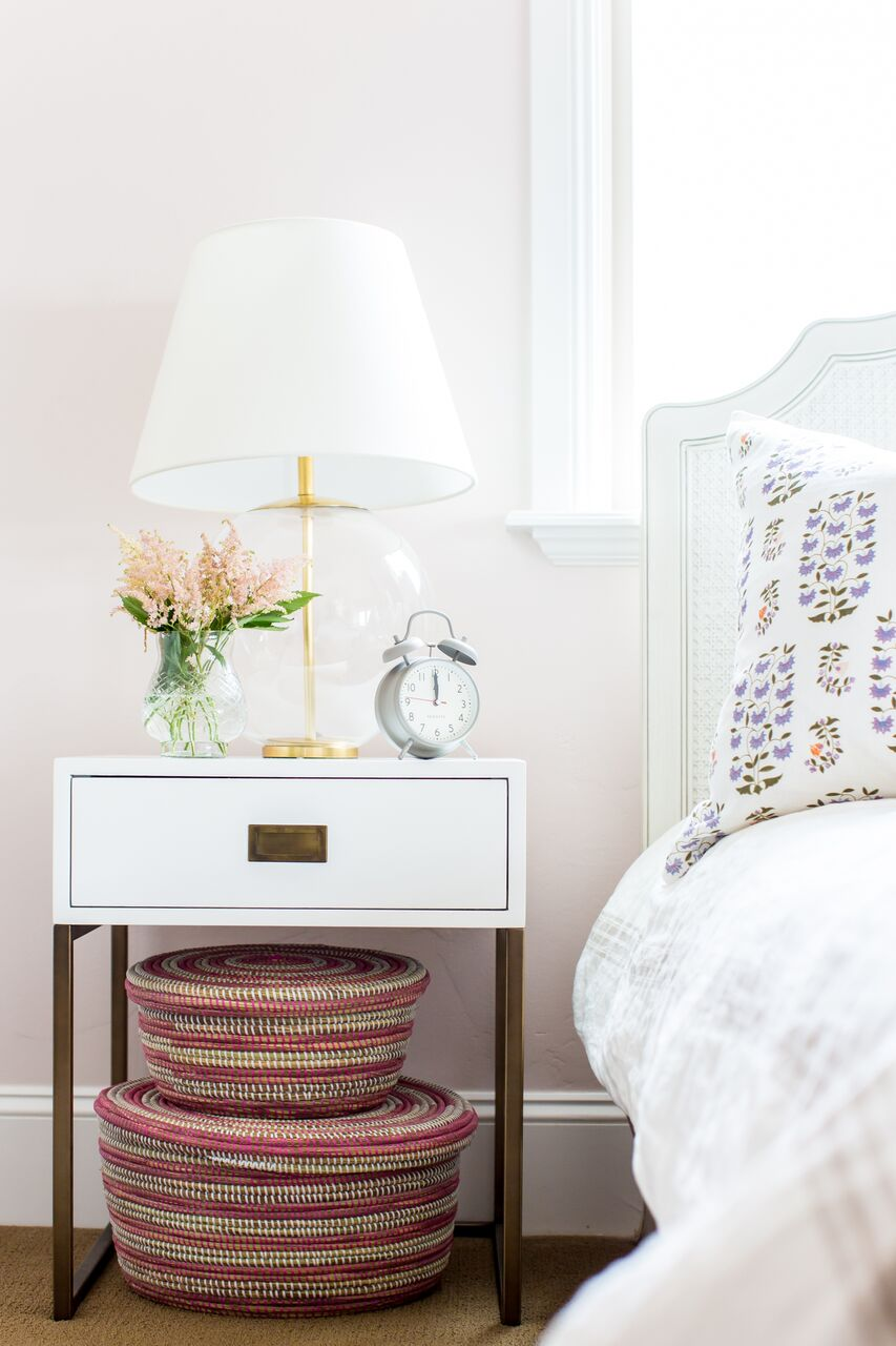 White minimalist nightstand next to bed