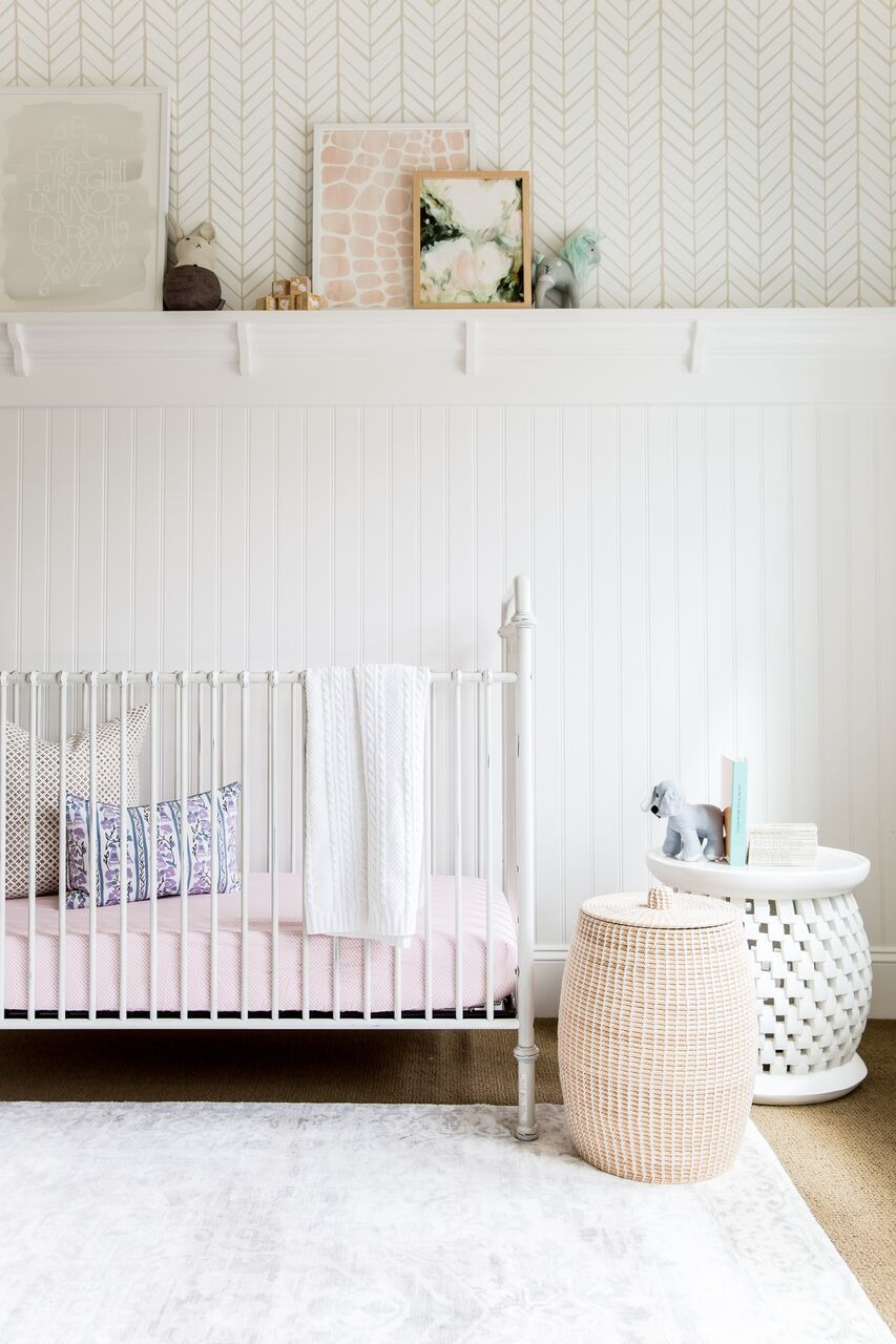 wicker storage baskets beside baby crib