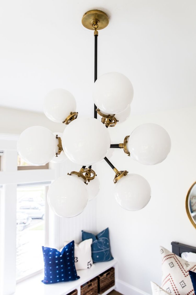 White and gold light fixture in bedroom