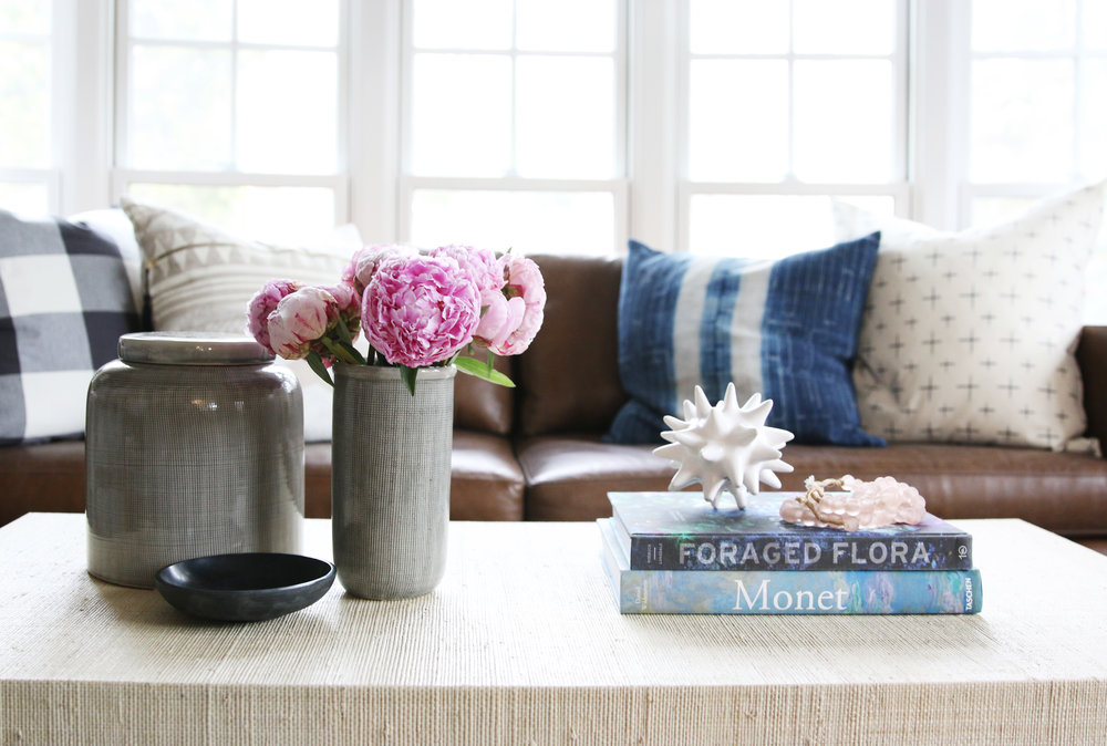 Books and flowers on top of coffee table