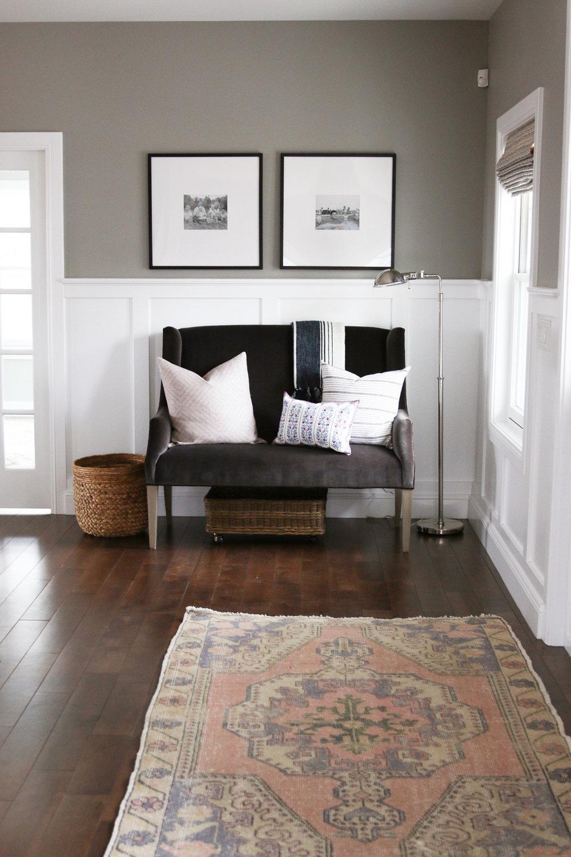 Grey sofa in entryway of home