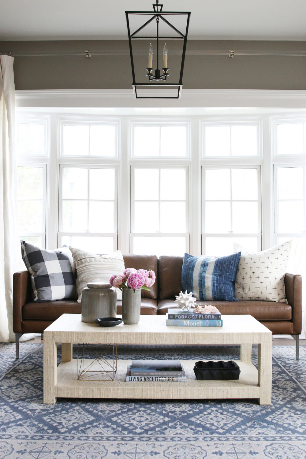 White coffee table in front of brown sofa