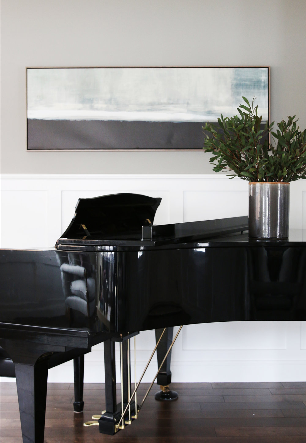 Large black grand piano in living room