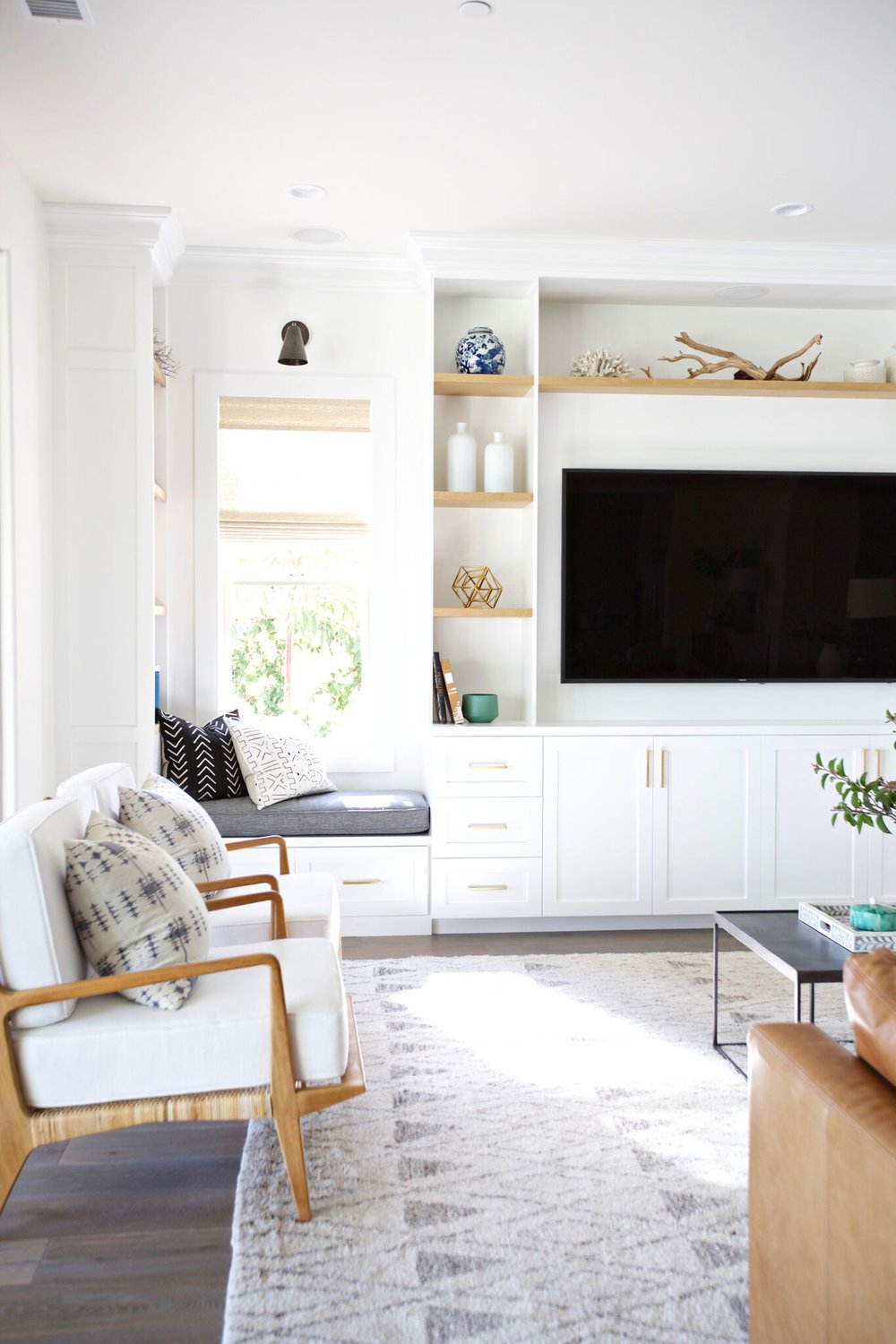 Bamboo white chairs with large flat screen TV