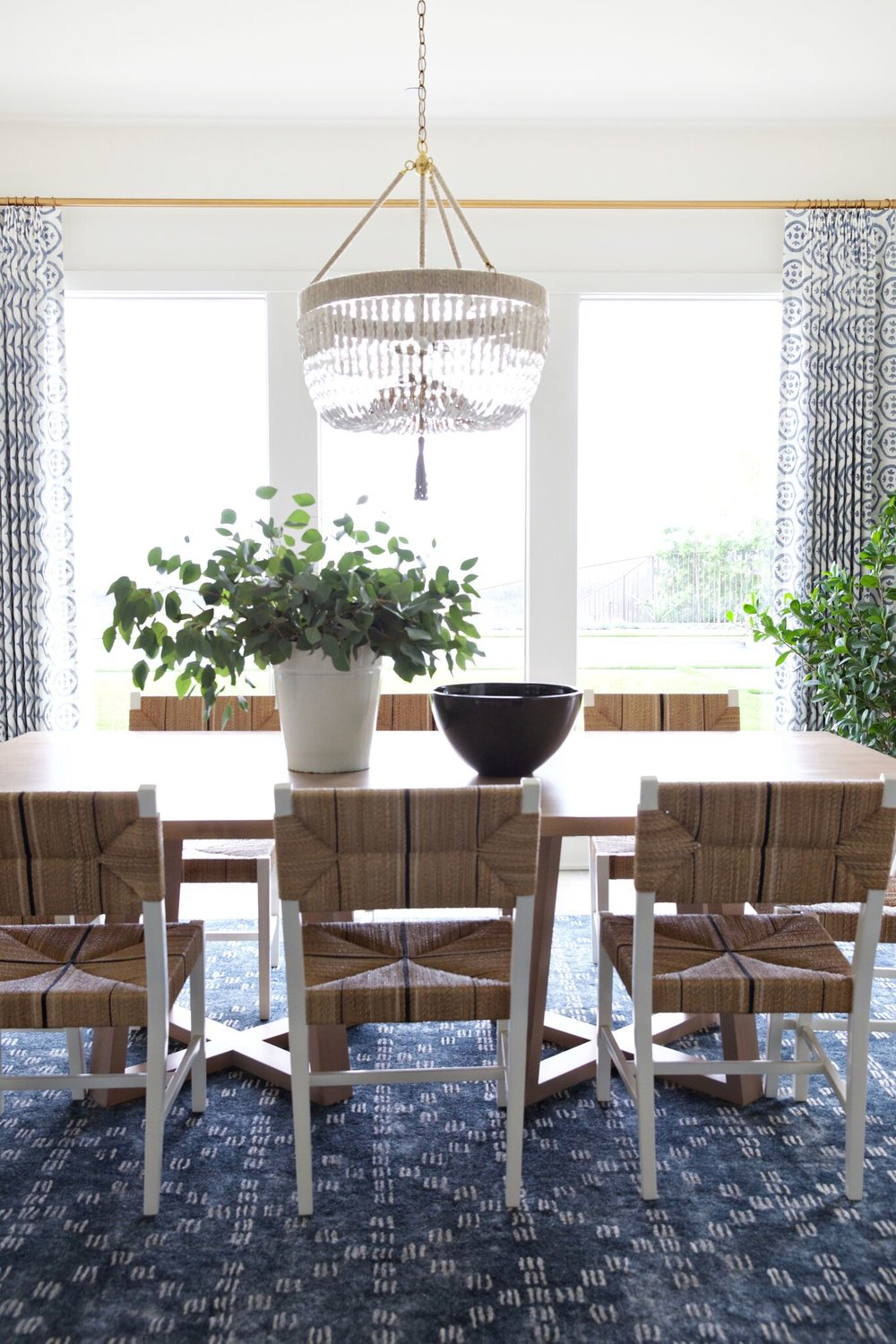 Modern dining table with golden light fixture