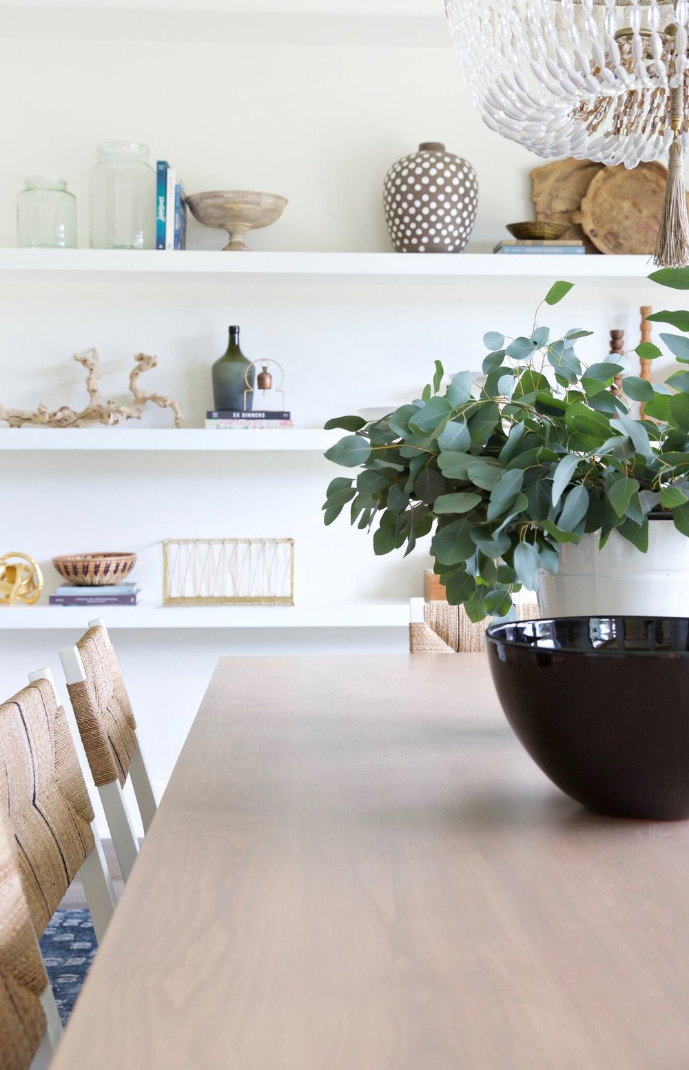 Bowls and plants on top of kitchen table