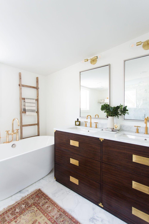 Front of dark wood vanity with gold fixtures