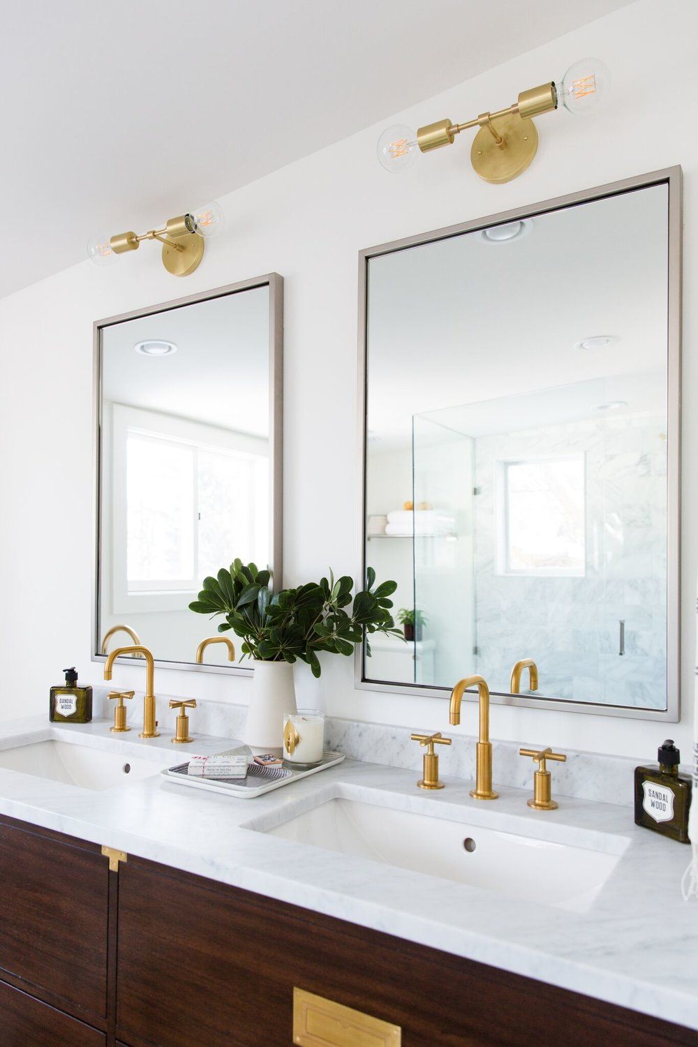 Top of dark wooden vanities with gold details