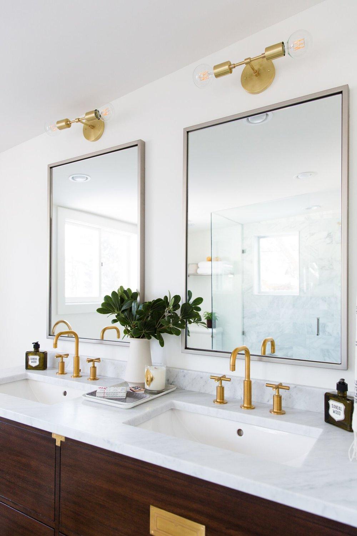 Top of dark wooden vanities with gold details