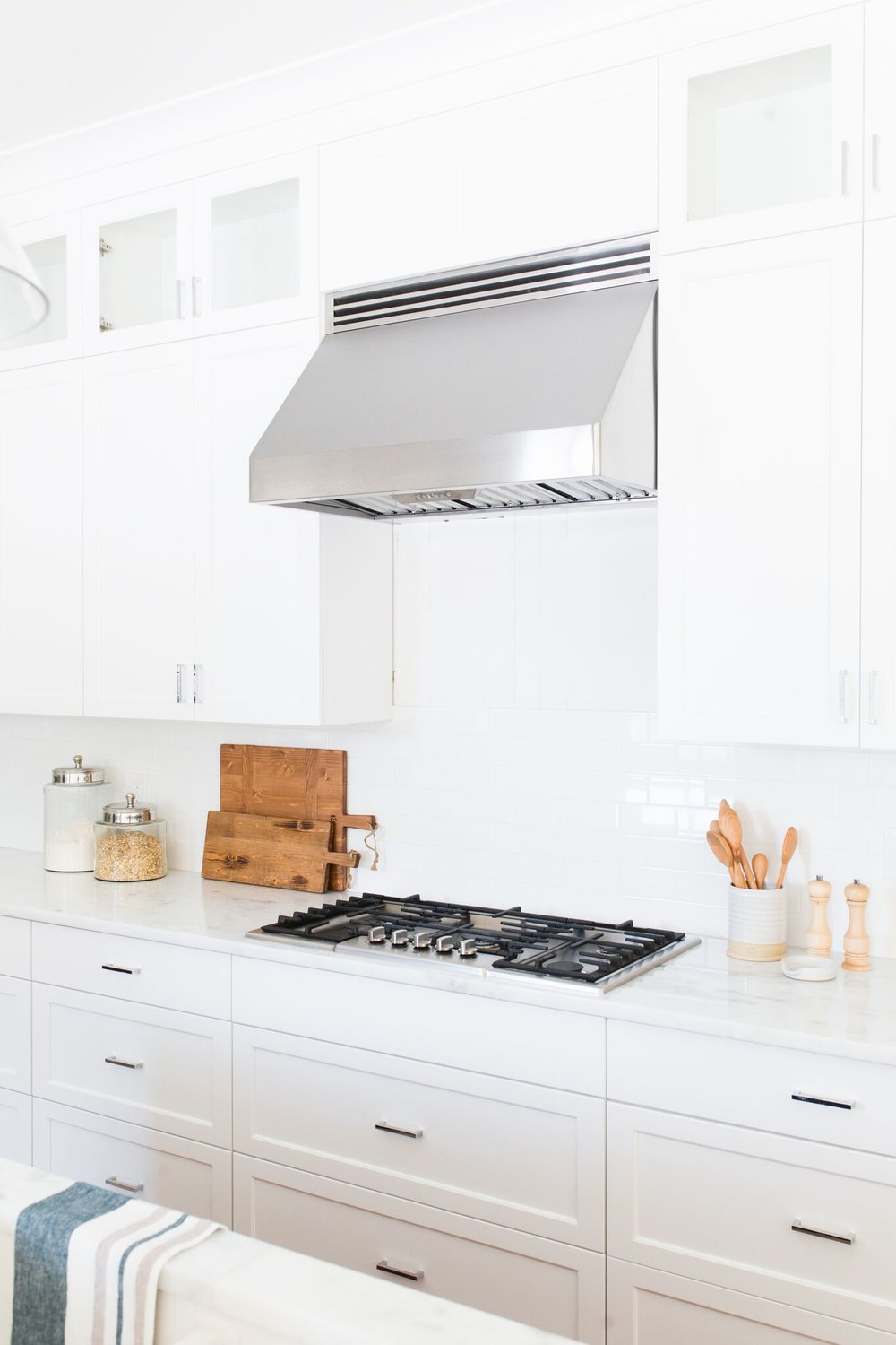 White cabinets with open range stove
