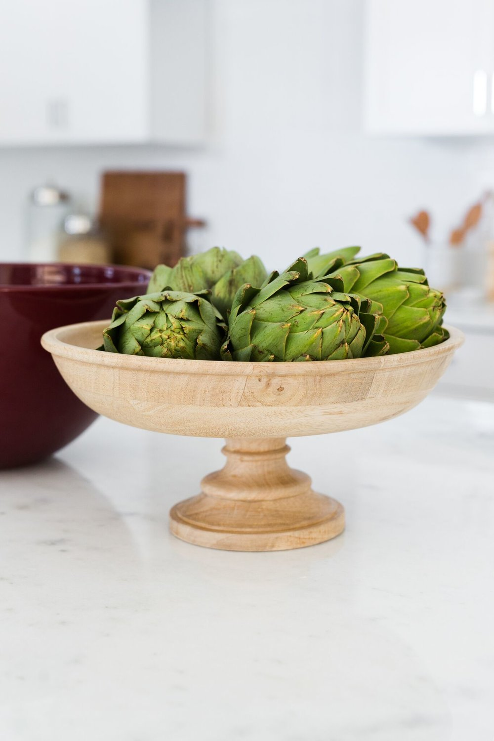 Bowl of artichokes on kitchen counter