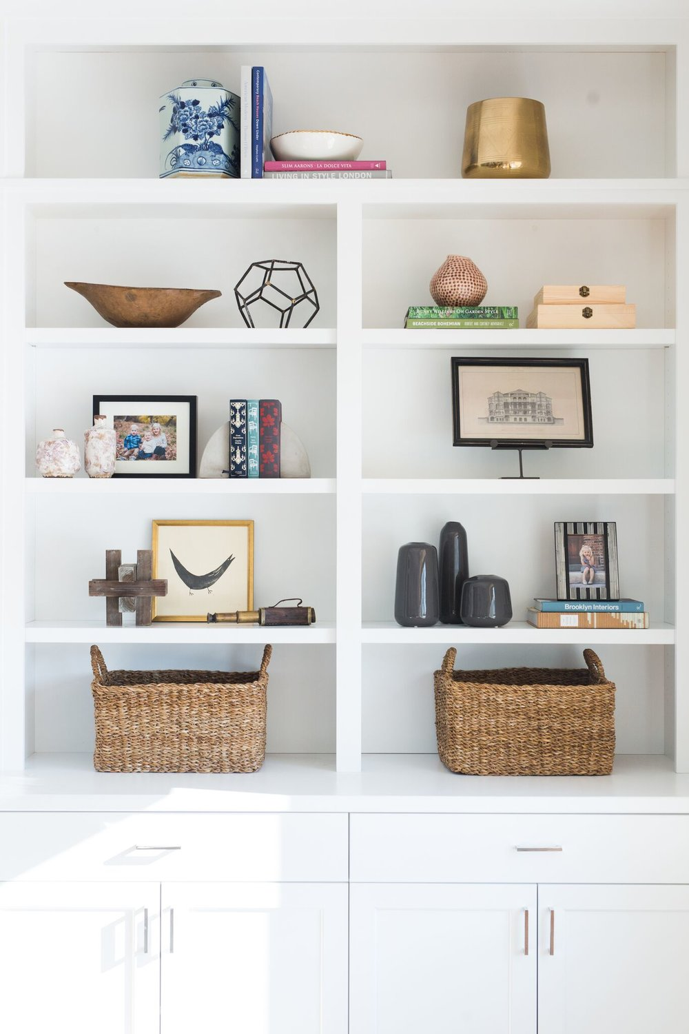 Baskets and pictures on built in shelf