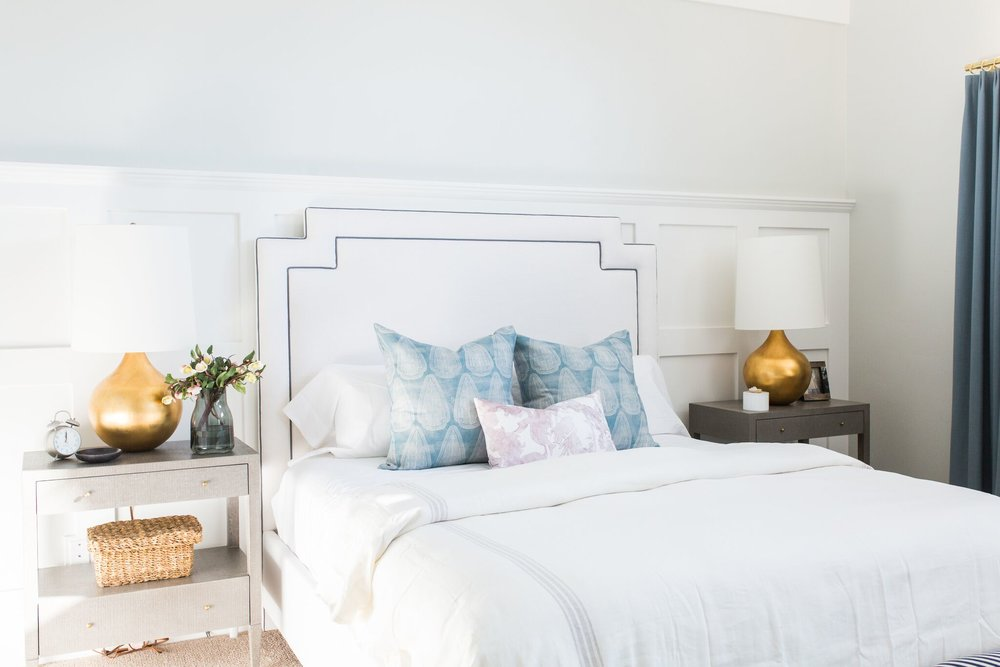 White bed with large white headboard