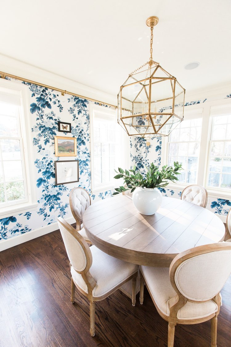 Round white dining table in home