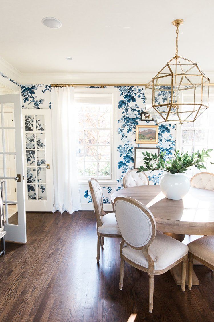 Round dining table against blue and white wallpaper