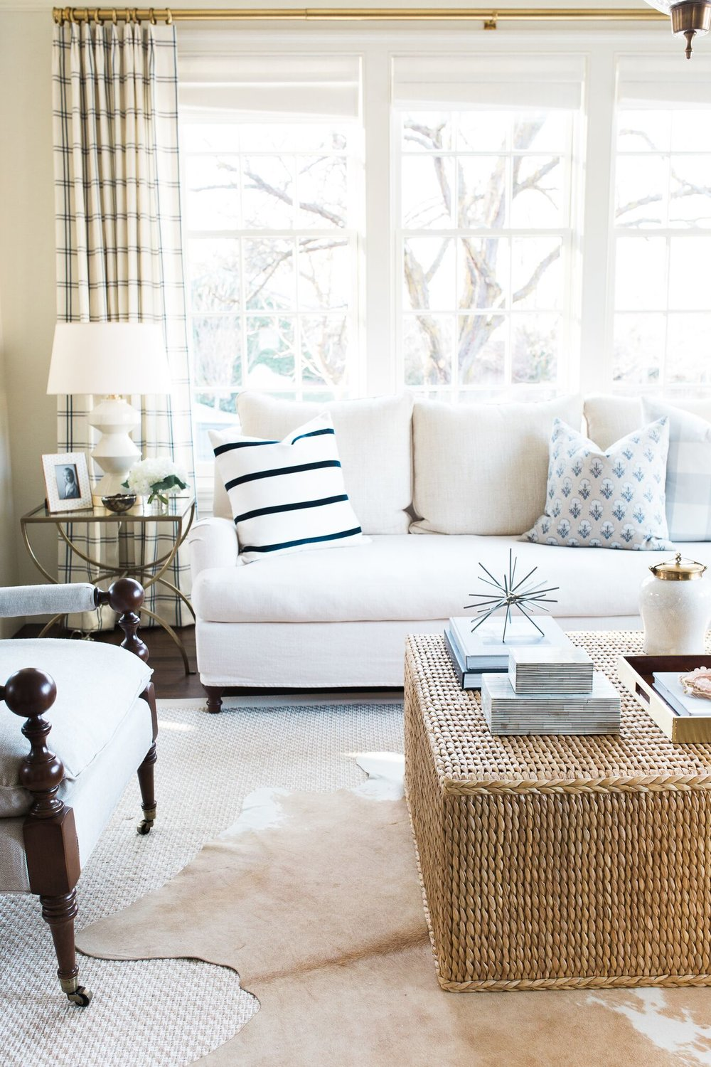 Wicker coffee table in front of white sofa