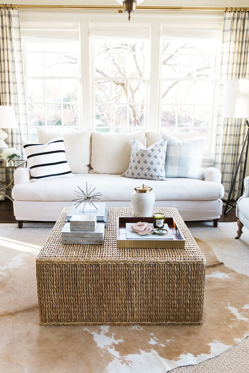 Large white sofa with decorative pillows