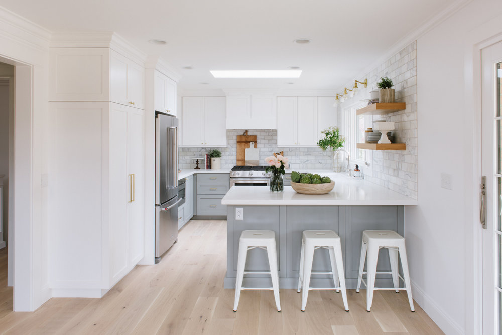 Three white stools at grey kitchen island
