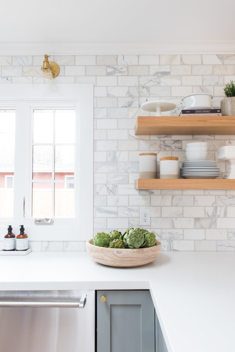 White counter top with white brick backsplash