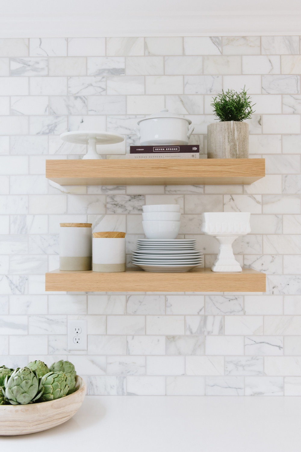 Two wooden built in shelves in kitchen