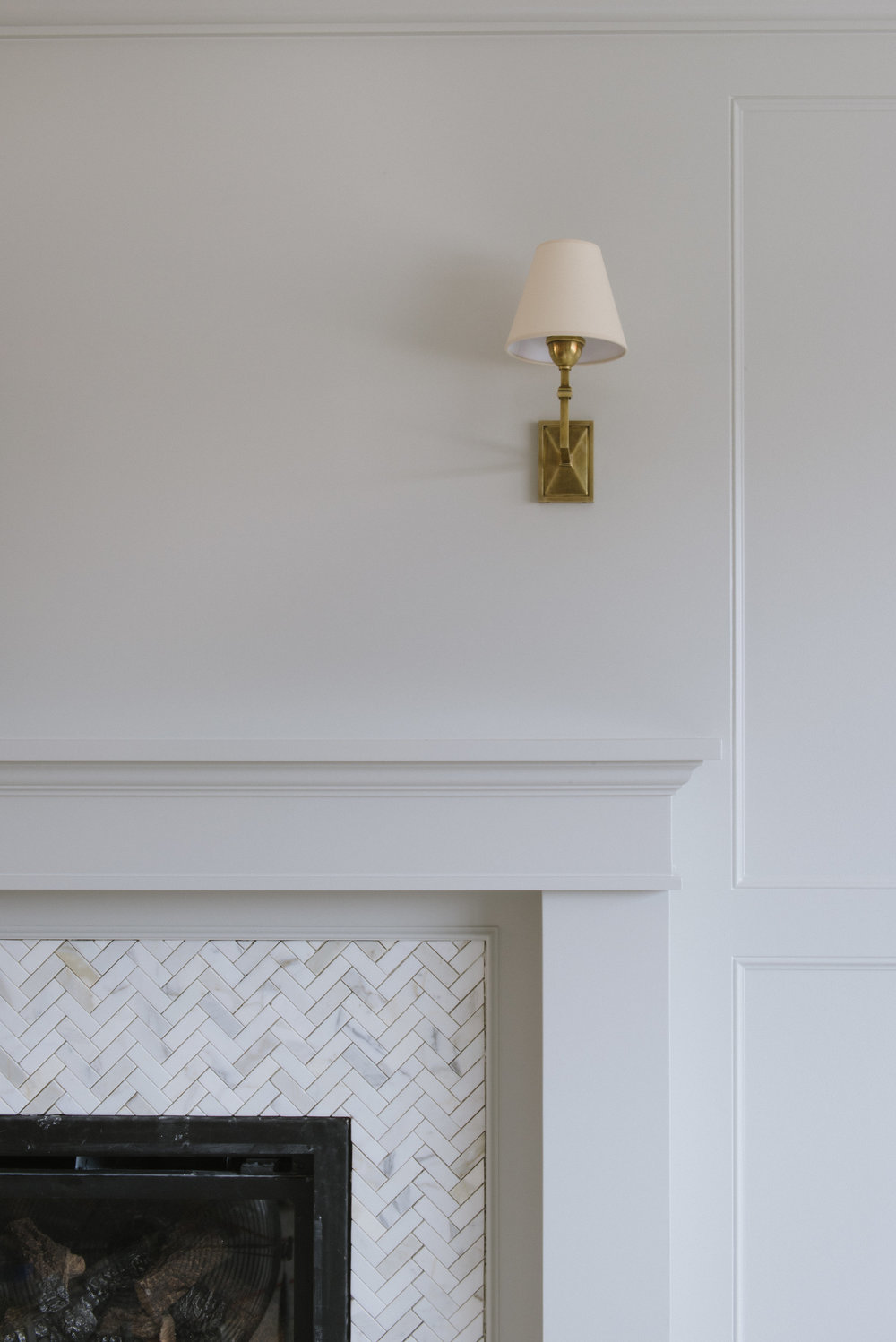 Fireplace mantel with golden lamp