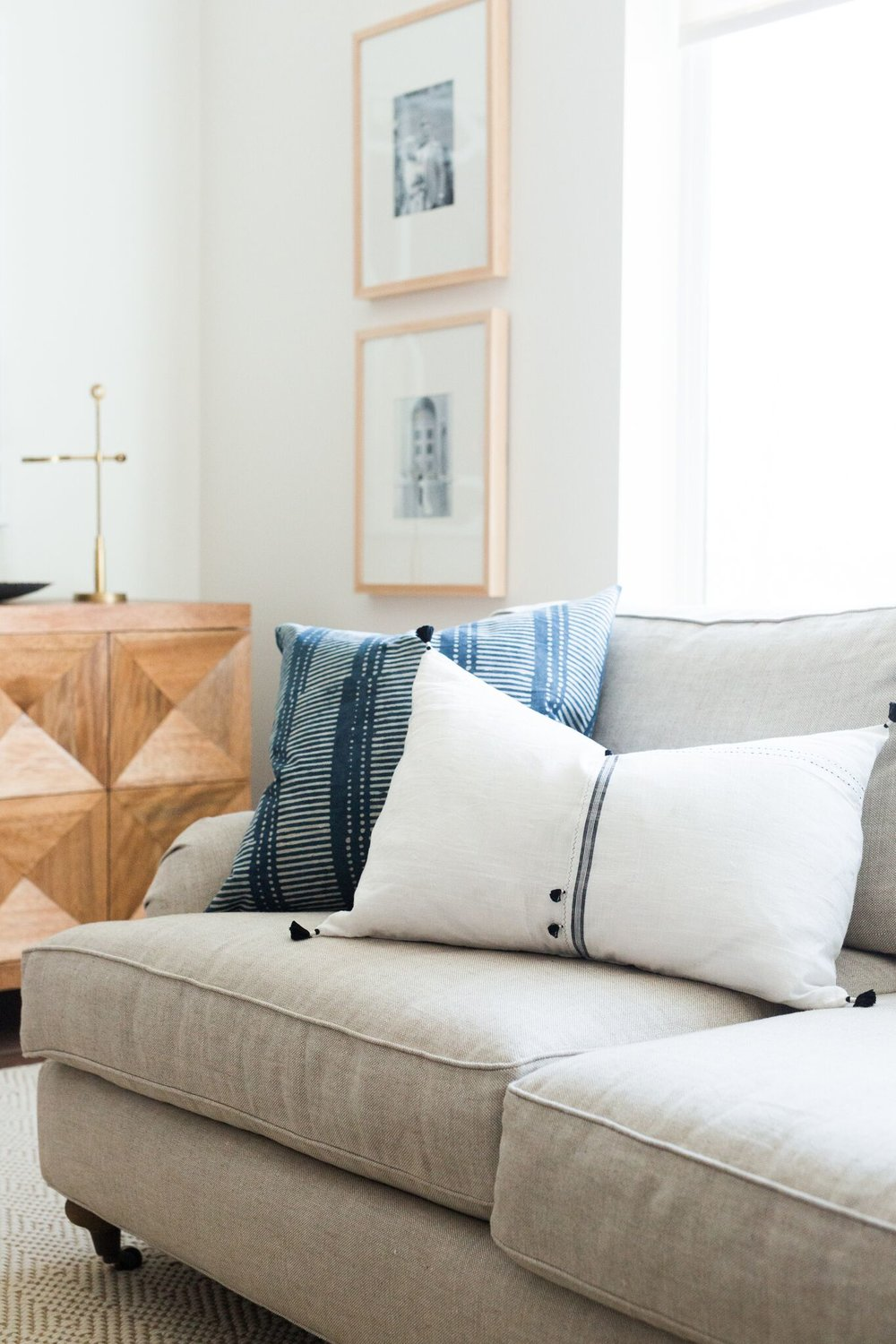 White couch with two decorative pillows