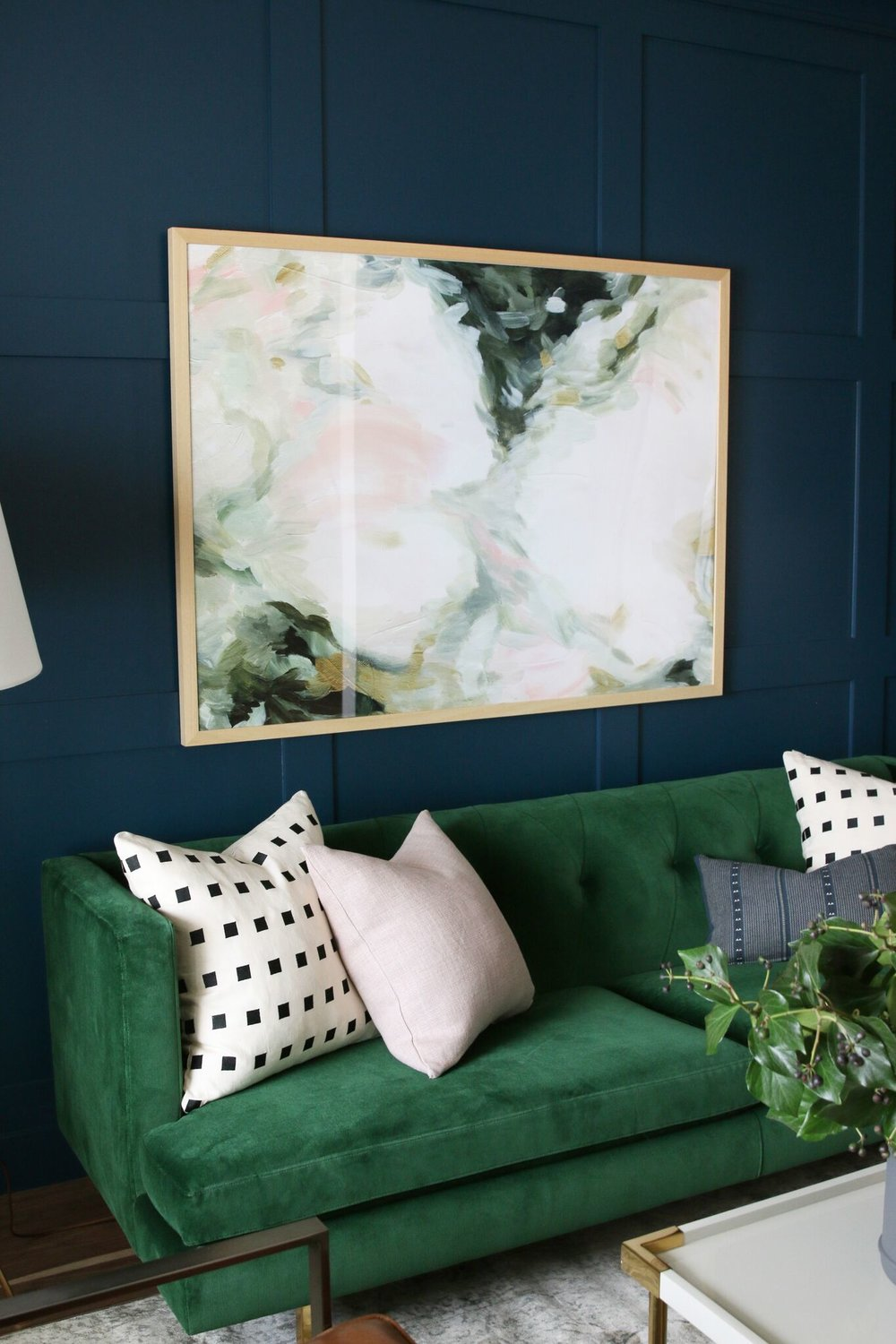 Green couch with decorative pillows