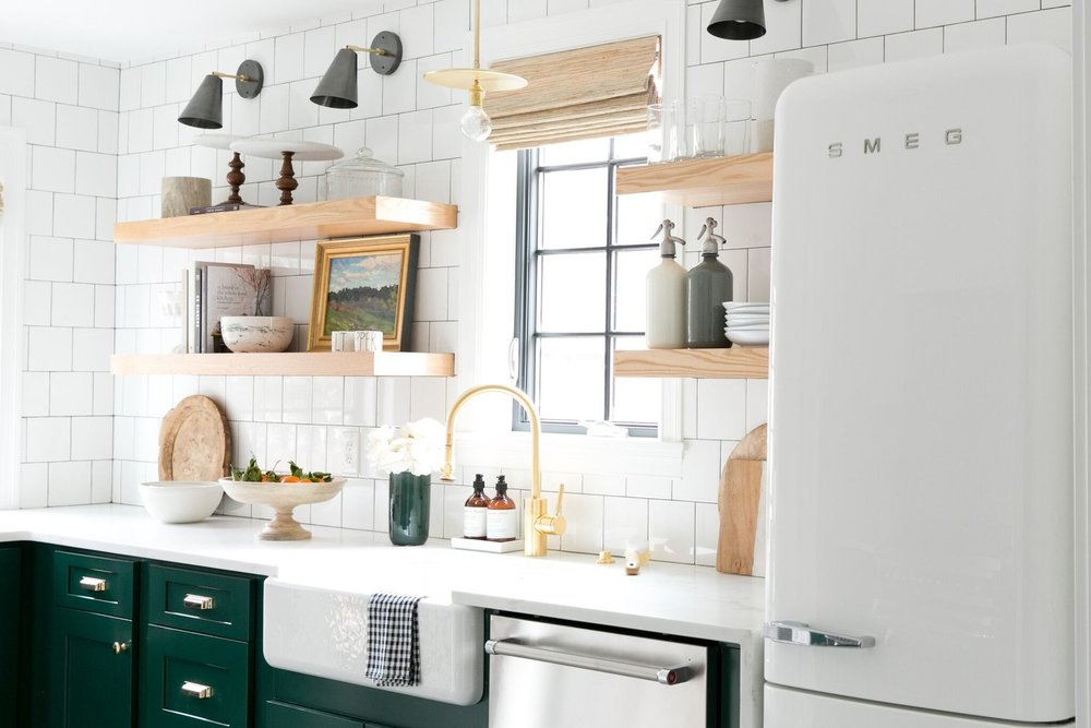 Modern Vintage Kitchen with cabinets in Benjamin Moore's Forest Green, and open shelving.