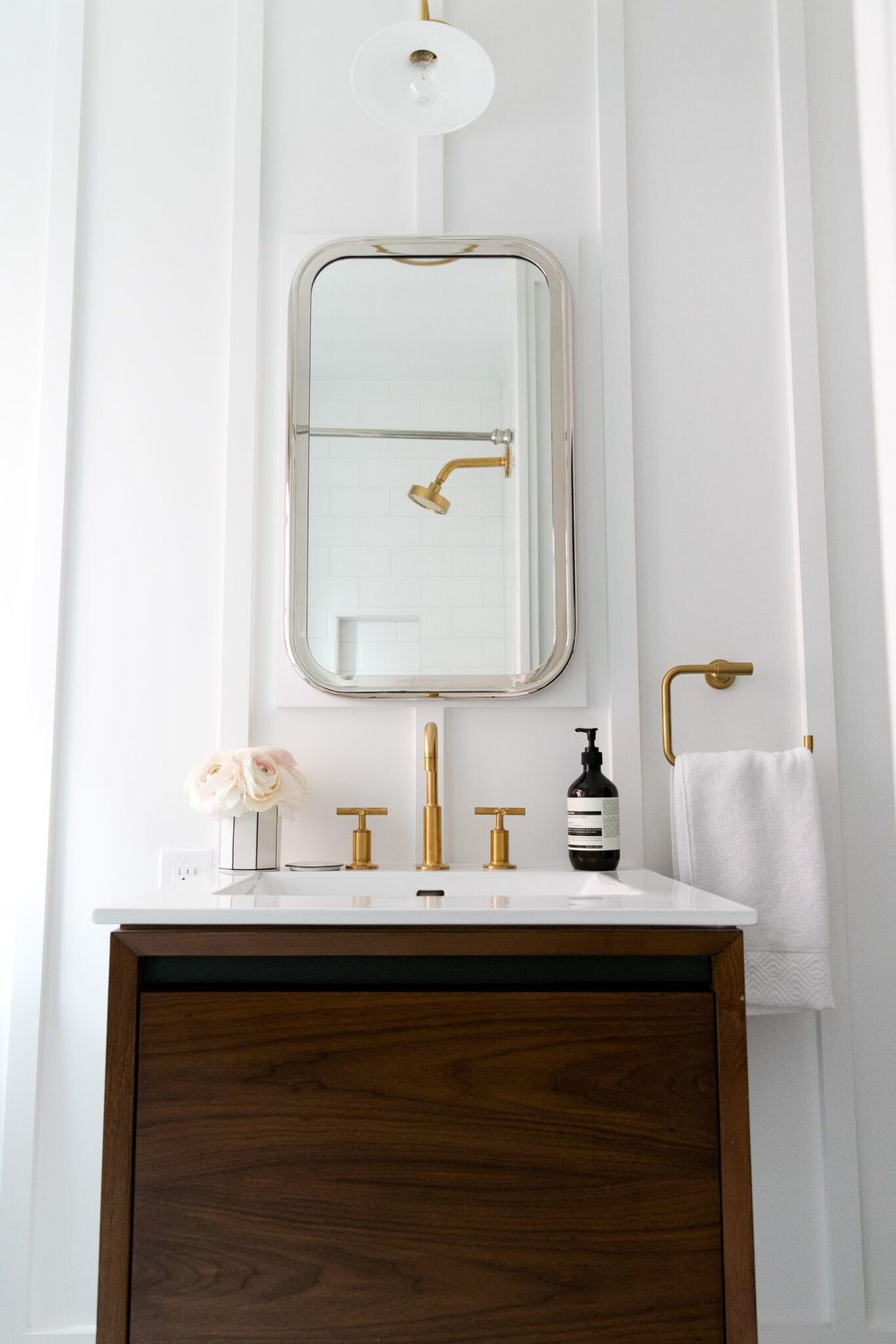Wooden vanity with small mirror