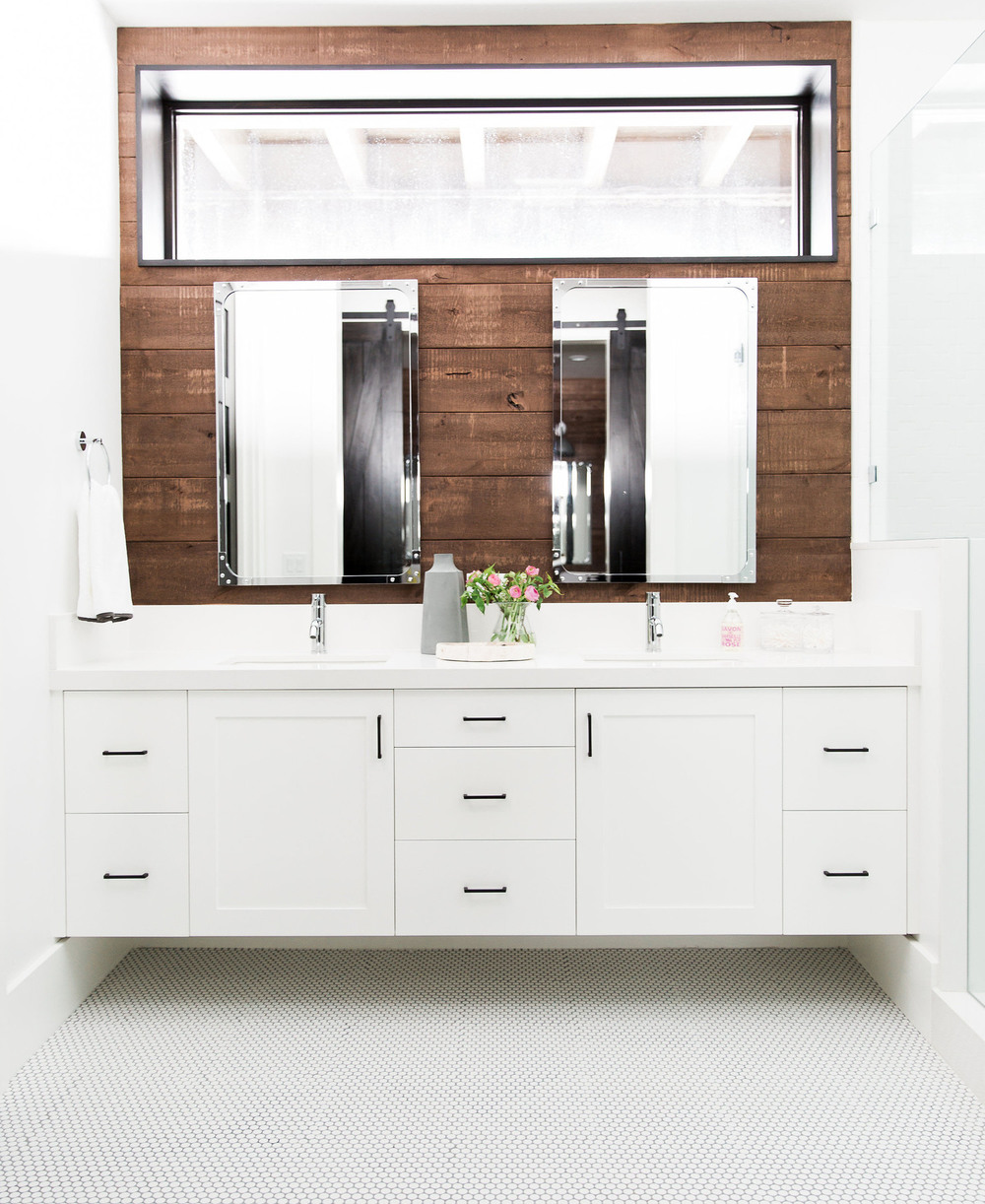 Clean and modern bathroom with natural wood accent wall.